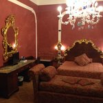 A triple room nicely decorated with traditional Venetian style.