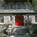Solid front door and granite stone blocks.