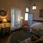 Provincial room has a queen bed, fireplace, A/C and a veranda overlooking gardens.