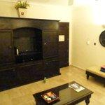 mini fridge, TV and bar