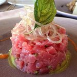 Tuna Tartar in a bed of guacamole with red pepper coulis