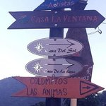 Signage pointing across the river to Casa La Ventana