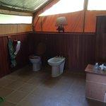 Inside tent -- toilet, bidet, shower