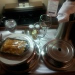 Room service was great; functional lamp/charge station behind.