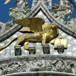 St.Mark's winged lion holds the book quoting-Peace to you Mark, my Evangelist