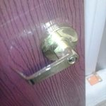 Bathroom door at Laquinta hotel; handle with sticky white body fluid