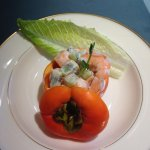 prawn salad in a fresh persimmon