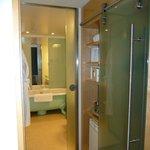 Sliding door to bathroom, minibar+safe on right