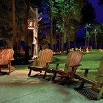 Adirondack chairs surrounding the Lodge campfire