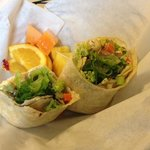 Picture of Veggie Wrap with a side of fruit.