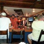 Patrons around the bar
