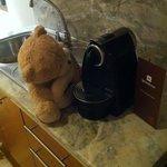 my teddy bear exploring the nespreso machine