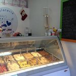 Gelato counter with daily flavors on the board