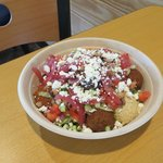 Cous-Cous bowl with falafel, hummus, spicy harissa, eggplant & red pepper spread, and toppings!