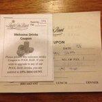 ツアーに付いてきたウェルカムドリンクチケット。15%OFFまたはオレンジジュース一杯無料。