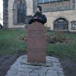 Tour guide Billy explaining the story of Greyfriars Bobby's grave