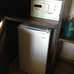 fridge and safe in armoire