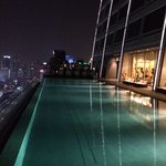 Outdoor pool night view, right hand side is the gym.