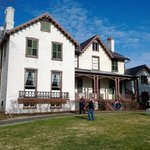 Visitors explore the lawn in front of President Lincoln's cottage