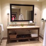 the vanity in the spacious bathroom