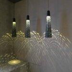 lighting fixtures in sauna/shower room in spa suite