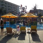 Little ones water playground has 4 mini slides, a big dumping bucket and heaps of spray toys