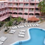 View of rooms opposite, pool and pool bar