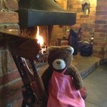 Barnaby Bear relaxing in front of the fire at The Swan, Ley Hill