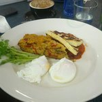 Vegetarian breakfast with eggs, home made baked beans and quinoa slice.