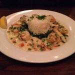 Mixed seafood with sauteed spinach an rice.