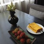 flower arrangement and fruits in our room
