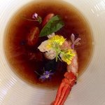 rooibos tea and tomato consommé with West Coast rock lobster and basil