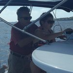 Captain Richard instructs my daughter on how to point the boat