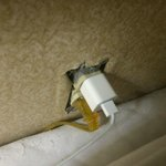 Uncovered outlet hanging out of wall against mattress! (Fire & Saftey hazard)