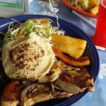 Plantine, tortilla, salad, pork chop