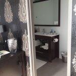 Large rectangular bathroom but door was too close to toilet and in frontons shower door