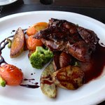 I had the steak with wine reduction and vegetables, quite good as well!