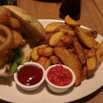 Chicken breast burger and onion rings.