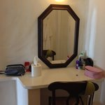 Makeup table outside bathroom