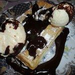 Waffle with ice cream and chocolate sauce, yum!