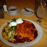 A delicious carne adovada red chile enchilada