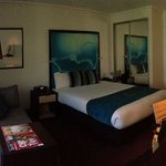 Standard room (Room 817) facing main street with queen size bed.