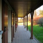 Covered walkway serving the motel style bedrooms.