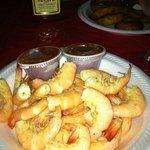 Hot steamed shrimp served with melted butter.