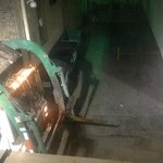 Garbage Truck directly outside first floor room at 6:15 a.m.