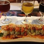 Spicy tuna/dynomite roll with a great selection of beer.