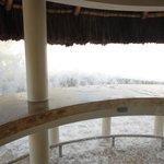 waves crashing over tiky hut sunset bar