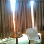 The Room's bow window and lovely armchairs