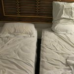 Deceiving beds: two singles put together to make it look like a queen. Super uncomfortable.