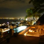 Roof top pool/palapa at night